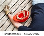 injured worker and hardhat on... | Shutterstock . vector #686279902