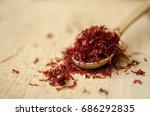 red color saffron in wooden...   Shutterstock . vector #686292835