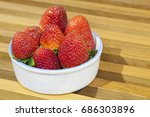 fresh strawberries in a bowl on ...   Shutterstock . vector #686303896