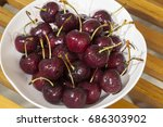 sweet cherry on a plate on...   Shutterstock . vector #686303902
