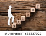 closeup of paper businessman...   Shutterstock . vector #686337022