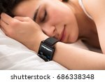 woman sleeping on bed with... | Shutterstock . vector #686338348