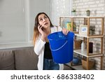 worried woman calling plumber... | Shutterstock . vector #686338402