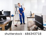smiling male janitor cleaning... | Shutterstock . vector #686343718