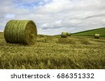 hay bales on yellow fields next ...
