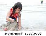 little asian girl playing with... | Shutterstock . vector #686369902