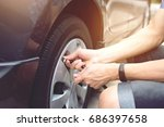 close up hand man car parking a ... | Shutterstock . vector #686397658