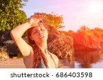 sunstroke on hot beach. young... | Shutterstock . vector #686403598