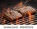 grilled pork ribs on the... | Shutterstock . vector #686405326