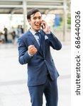 Small photo of Young business man excite and enjoy of business success on cooperate with partner, portrait smart business man with excite enjoy acting action