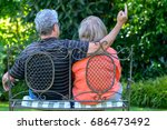 senior couple sitting on a... | Shutterstock . vector #686473492