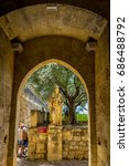 Small photo of Stone statue of a Knight at the entrance of the Alcazar palace in Cordoba, Spain, Europe