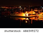 Small photo of Sailing boats moored in Hobson Bay at night. Auckland, New Zealand