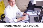 young businessman working in... | Shutterstock . vector #686549926