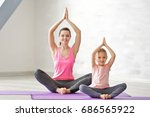 mother and daughter doing... | Shutterstock . vector #686565922