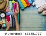 woman packing a luggage for a... | Shutterstock . vector #686581732