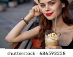 woman with red lips sits in...   Shutterstock . vector #686593228