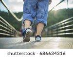 walking women and sneaker shoes  | Shutterstock . vector #686634316