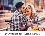 couple riding their bikes in... | Shutterstock . vector #686643418