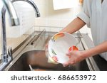 hands washing the dishes on... | Shutterstock . vector #686653972