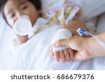 hands of mother and sick asian... | Shutterstock . vector #686679376