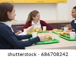 children sitting at table in... | Shutterstock . vector #686708242