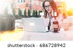 young businesswoman in glasses... | Shutterstock . vector #686728942
