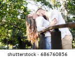 sexy macho man kissing woman... | Shutterstock . vector #686760856