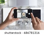 hand using phone taking picture ... | Shutterstock . vector #686781316