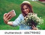 beautiful young woman doing... | Shutterstock . vector #686798482