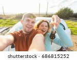 young funny couple with keys to ... | Shutterstock . vector #686815252