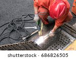 worker use iron oxide electrode ... | Shutterstock . vector #686826505