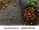 roasted chestnuts on an old...   Shutterstock . vector #686828968