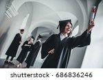 happy female student graduate... | Shutterstock . vector #686836246