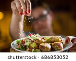 woman preparing a meal in the... | Shutterstock . vector #686853052
