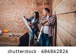happy couple making repairs to... | Shutterstock . vector #686862826