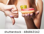 diet. donut no. a young girl... | Shutterstock . vector #686863162