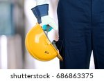 worker in a  construction site | Shutterstock . vector #686863375