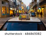 Small photo of Taxi cab on an Old Town street of Porto, Portugal