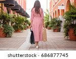 woman outlet shopping concept | Shutterstock . vector #686877745