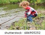 a little boy is splashing the...   Shutterstock . vector #686905252