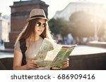 girl reading a map travelling... | Shutterstock . vector #686909416