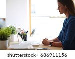 woman sitting on the desk with... | Shutterstock . vector #686911156
