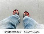 man feet top view wearing jeans ... | Shutterstock . vector #686940628