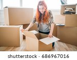woman unpacking cardboard boxes ... | Shutterstock . vector #686967016