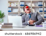 Small photo of Clown businessman having fun in the office