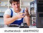 computer repairman repairing... | Shutterstock . vector #686994052
