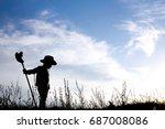a silhouette little boy cowboy... | Shutterstock . vector #687008086
