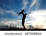 silhouette of father and son... | Shutterstock . vector #687008866