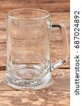 empty beer mug isolated on... | Shutterstock . vector #687024892